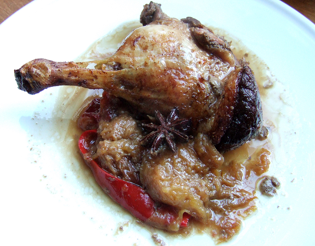 Baked spiced duck legs with plums